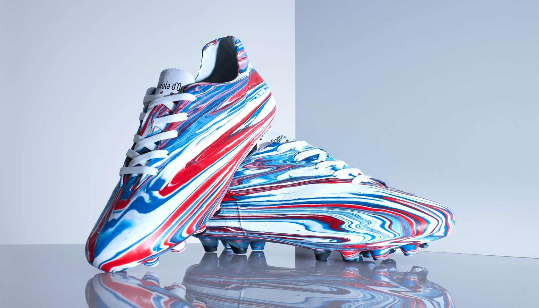 One of a kind Pantofola d'Oro 'Lazzarini' football boots created by Craig Black for Ranger FC using an acrylic fusion paint–pouring technique in the clubs red, white and blue.